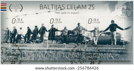 LATVIA - CIRCA 2014: A stamp printed in Latvia shows Baltic Chain, devoted The 25th Anniversary of Independence - Joint Issue with Estonia and Lithuania, circa 2014 - stock photo