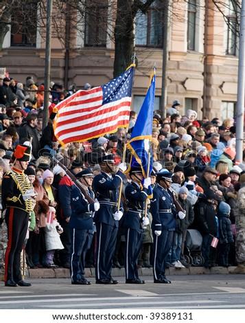 LATVIA - NOVEMBER 18: USA Color Guard at Military parade of the National Armed Forces. 90th anniversary of establishment of the Republic of Latvia. Riga November 18, 2008. - stock photo