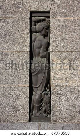 """Latvia Riga Historical center Art nouveau or German """"jungendstil"""" detail of facade with figure in bronze set in silver granite stone - stock photo"""