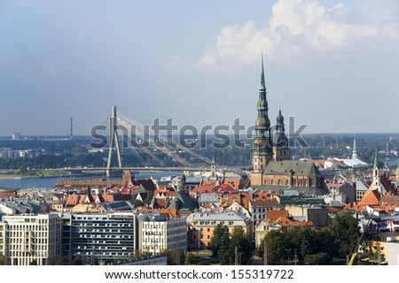 Latvia, Riga. The top view on the old city and the modern bridge - stock photo