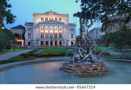 Latvian national opera and ballet theater and fountain the Nymph in park. Riga, Latvia. - stock photo