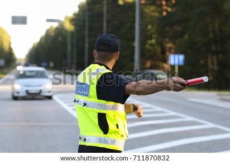 Latvian police man is directing traffic