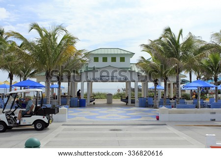 Lauderdale-By-The-Sea, FL, USA - September 20, 2014:  A view of the modern pavilion at the east end of Commercial Boulevard. People gather at a large beach pavilion - stock photo