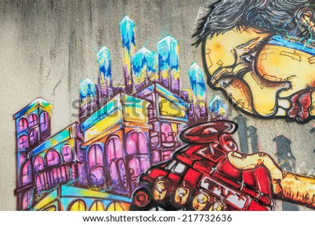 LAUDUN, FRANCE - May 08, 2014: City- Graffiti painted on the wall of the Forum sport center in Laudun, France on May 08, 2014.