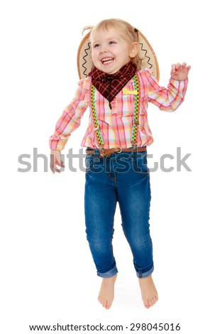 Laughing a little charming girl in jeans and a plaid shirt joyfully jumping in the Studio-Isolated on white