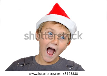 Laughing adorable child with Santa Hat - stock photo