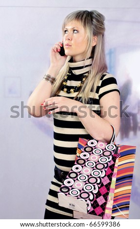 laughing adult girl with shopping bags