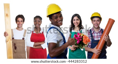 Laughing african american construction worker with group of other workers - stock photo