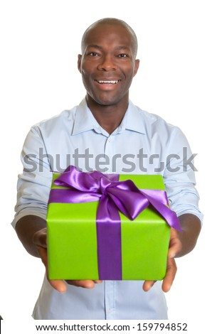 Laughing african man showing a gift for christmas - stock photo