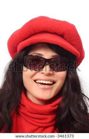 Laughing Asian girl in dark glasses, red cap and scarf, isolated on white background