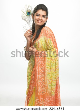 Laughing asian woman with peacock feathers - stock photo