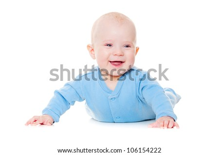 laughing baby boy lying on floor. isolated on white background - stock photo