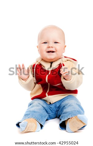 Laughing baby boy sits clapping, isolated - stock photo