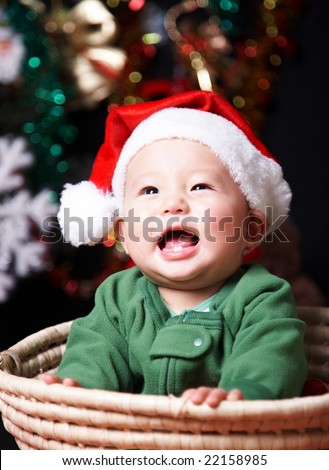 laughing baby in a santa hat. - stock photo