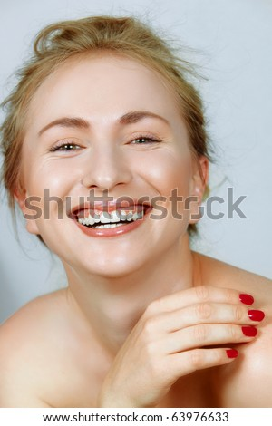 laughing beautiful young woman with fine laugh lines around her eyes. - stock photo