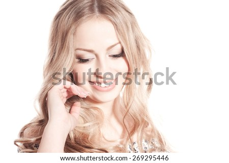 Laughing blonde girl posing over white. Isolated. Looking down. Long hair.