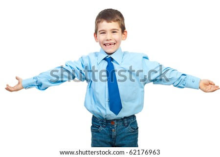 Laughing boy in elegant clothes standing with hands open to embrace someone isolated on white background - stock photo