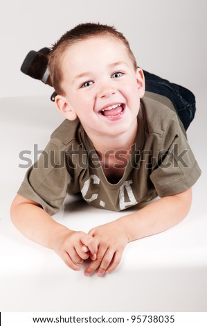laughing boy in studio - stock photo