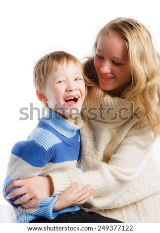 Laughing boy with his beautiful mother on white background