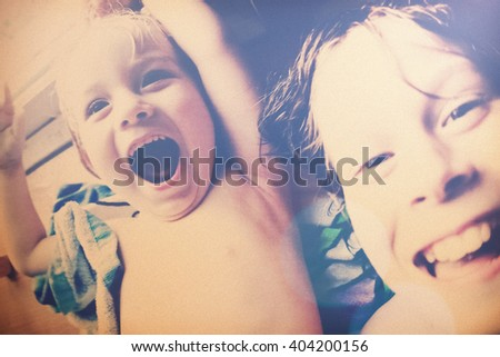 Laughing brothers selfie, filtered, snapshot image, noise added. - stock photo
