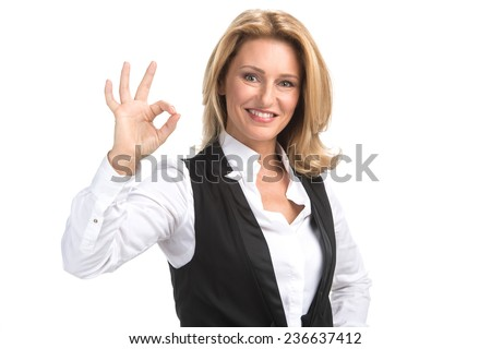 Laughing business woman in white shirt. Attractive mature businesswoman on white background giving ok sign - stock photo
