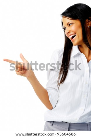 Laughing businesswoman points to imaginary product in studio, isolated on white - stock photo