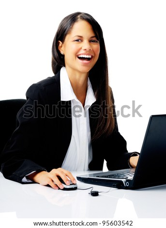 laughing businesswoman uses laptop at her desk, isolated on white