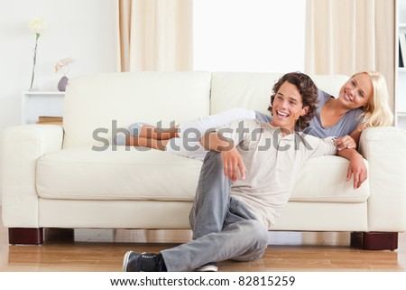 Laughing couple posing in their living room