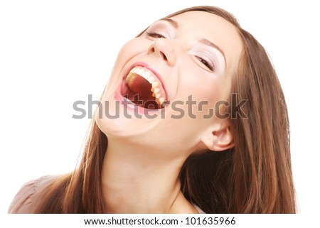 Laughing female. Portrait of a beautiful laughing young female, studio shot. - stock photo