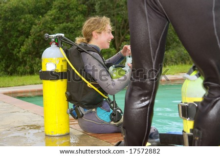 Laughing female student in divers training pool. - stock photo