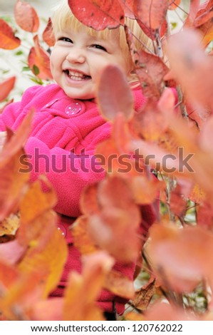 laughing girl standing in bushes - stock photo
