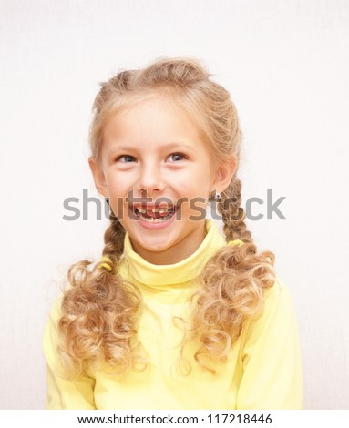 Laughing girl with fallen milk teeth - stock photo