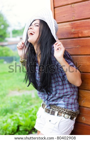 Laughing in the back yard - stock photo