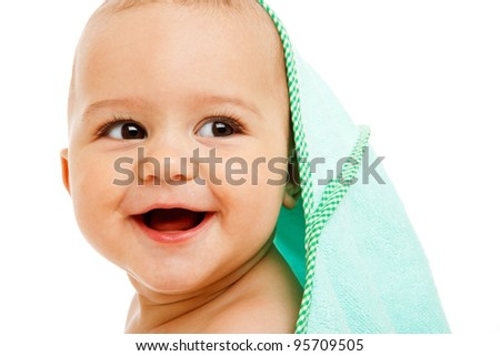 Laughing infant covered with towel - stock photo