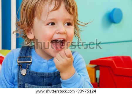 Laughing kid portrait with room on background - stock photo