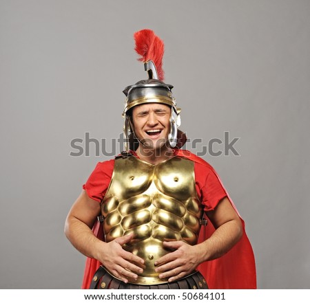 Laughing legionary soldier - stock photo