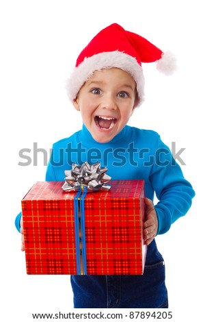 Laughing little boy in Santa's hat with red gift box, isolated on white