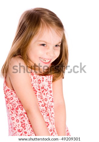 Laughing little girl looking away isolated on white - stock photo