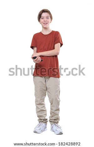 laughing male teenager with smart phone in one hand, isolated on white. - stock photo
