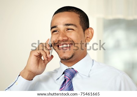 Laughing man on mobile phone - stock photo