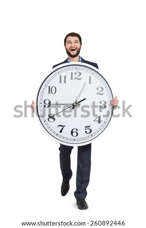 laughing man walking with big clock. isolated on white background - stock photo