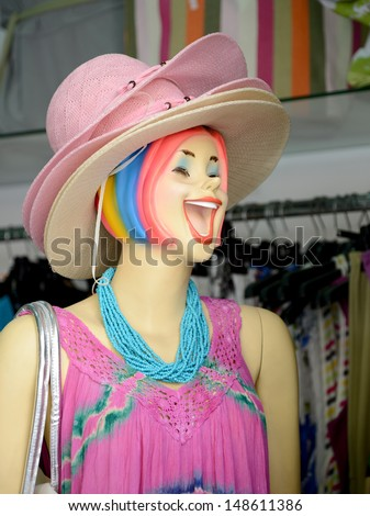 Laughing mannequin and many hats in the store of women's clothes