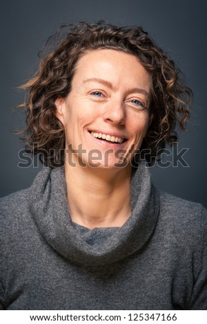 Laughing middle aged woman close up portrait. - stock photo
