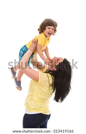 Laughing mother raising her happy son and having fun together isolated on white background