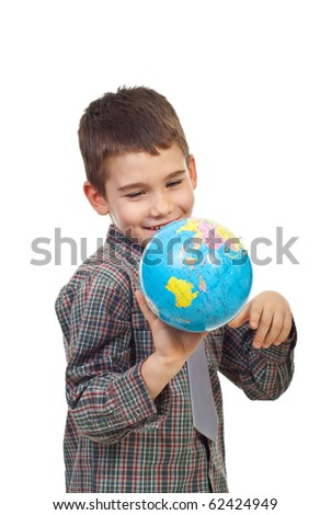 Laughing preschool boy playing with a globe isolated on white background - stock photo