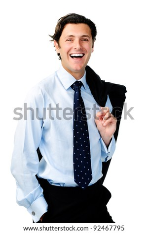 Laughing relaxed businessman stands with his suit jacket over his shoulder - stock photo