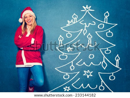 laughing Santagirl standing in front of a chalkboard - Santagirl - stock photo