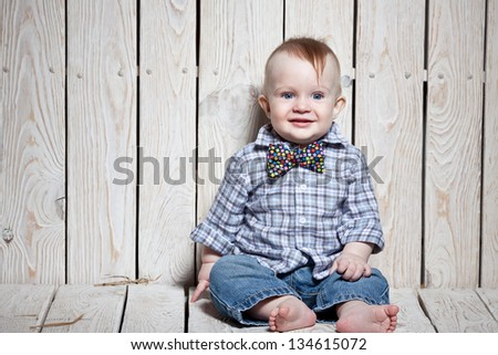 laughing  stylish kid  in bow tie - stock photo