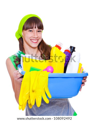 Laughing teenage girl ready for domestic work - stock photo