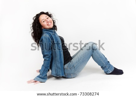 Laughing woman sitting - stock photo
